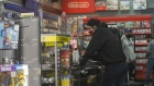 Shoppers wear protective masks inside a GameStop Corp. store in San Diego, California, U.S., on Monday, Jan. 25, 2021. California, a recent epicenter of the coronavirus pandemic, has lifted its regional stay-at-home orders as the outbreak slows across the state and hospitalizations ease. Photographer: Bing Guan/Bloomberg