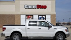 A truck sits parked outside a GameStop Corp. store in Oswego, Illinois, U.S., on Monday, April 1, 2019. GameStop is scheduled to release earnings figures on April 2.