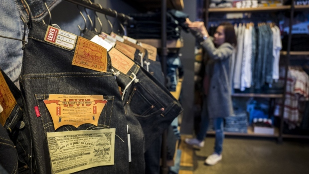 A shopper views merchandise for sale inside the Levi Strauss & Co. flagship store in San Francisco, California, U.S., on Monday, March 18, 2019. Levi Strauss & Co.'s initial public offering, currently set at 36.7 million shares seen pricing at $14 to $16 each, is expected to price on March 20 according to the NYSE website. Photographer: David Paul Morris/Bloomberg