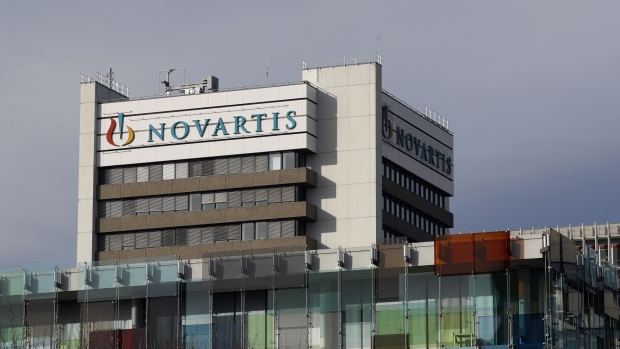 A logo sits on display on a building at the Novartis AG campus in Basel, Switzerland, on Wednesday, Jan. 16, 2019. Trying to streamline an operation that spends more than $5 billion a year on developing new drugs, Novartis dispatched teams to jetmaker Boeing Co. and Swissgrid AG, a power company, to observe how they use technology-laden crisis centers to prevent failures and blackouts.