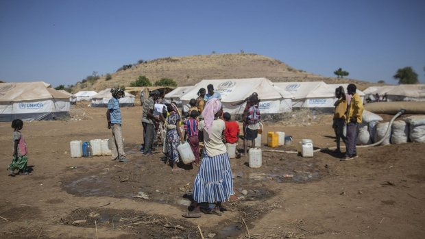People collect water at a refugee camp in Um Rakuba, Sudan on Jan. 8.