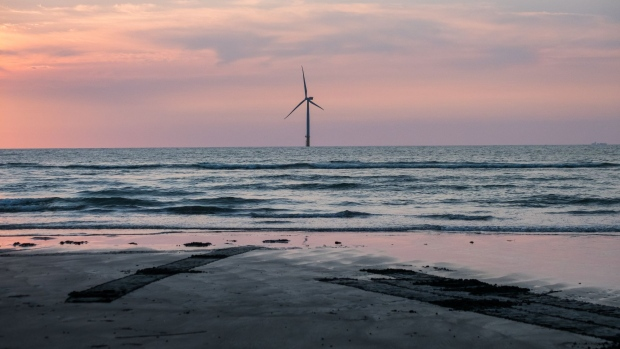 An offshore wind turbine, operated by Swancor Holding Co., stands in the Taiwan Strait off the coast of Miaoli County, Taiwan, on Thursday, July 26, 2018. Since a disastrous 2011 reactor meltdown in Japan, more than 1,400 miles (2,250 kilometers) away, Taiwan has rewritten its energy plans. President Tsai Ing-wen ordered all of the country's nuclear reactors to shut by 2025. Photographer: Billy H.C. Kwok/Bloomberg