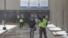 Workers enter the Canada Post Corp. Gateway East sorting facility in Toronto, Ontario, Canada, Tuesday, Jan. 26, 2021. Canada Post says it has begun testing an entire shift of employees for Covid-19 at a Mississauga facility after 121 workers there tested positive for the virus in the last three weeks, CBC News reports. Photographer: Cole Burston/Bloomberg