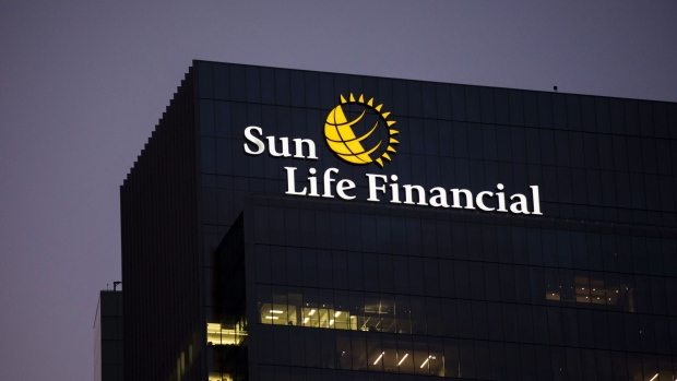 Signage is illuminated outside the Sun Life Financial Inc. headquarters in Toronto, Ontario, Canada, on Sunday, Aug. 11, 2019. Sun Life reached its lowest ever coupon for any of its bonds with the issuance of its first sustainable notes in a fresh sign that demand for such debt is increasingly driven by general investors scratching for some yield above inflation.