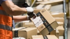 An employee scans a package at an Amazon.com Inc. fulfillment center in Kegworth, U.K., on Monday, Oct. 12, 2020. Prime Day, a two-day shopping event Amazon unveiled in 2015 to boost sales during the summer lull, usually occurs in July, but this year got pushed to Oct. 13 in 19 countries, including Brazil, with over 1 million products for sale worldwide. Photographer: Chris Ratcliffe/Bloomberg
