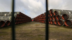 Sections of Nord Stream 2 pipes at the Baltic port of Mukran on the island of Ruegen in Sassnitz, Germany, on Wednesday, Nov. 4, 2020. Chancellor Angela Merkel's district on the Baltic coast was the site of the last major Soviet military project in communist East Germany and is now at the center of a deepening rift between Cold War allies. Photograph: Alex Kraus/Bloomberg Photographer: Alex Kraus/Bloomberg