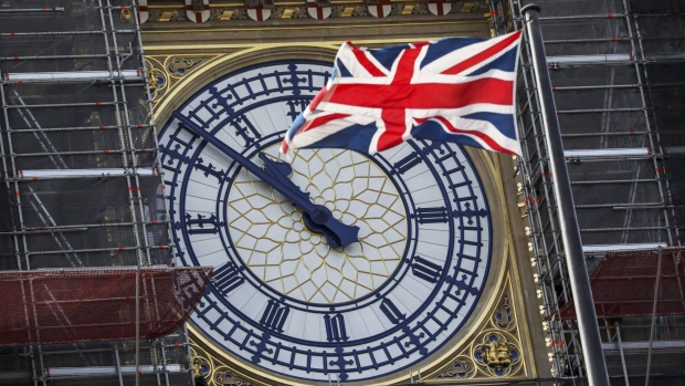 FILE: A British Union flag, also known as a Union Jack, flies in front of the clock face on the Elizabeth Tower, also known as Big Ben, of the Houses of Parliament in the Westminster district of London, U.K., on Wednesday, Aug. 28, 2019. European Union and Jack flags as Brexit trade talks that were on the verge of a breakthrough descended into a fight between the U.K. and France on Thursday as the British government said prospects of an imminent deal had receded. Photographer: Simon Dawson/Bloomberg