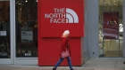 A shopper passes in front of a North Face Inc. store at the Easton Town Center Mall in Columbus, Ohio, U.S., on Thursday, Jan. 7, 2021. The U.S. Census Bureau is scheduled to release retail sales figures on January 15.
