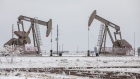 Pumpjacks operate in the snow in the Permian Basin in Midland, Texas, U.S,