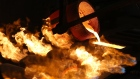 Molten gold pours from a crucible into a mold during the casting of large gold ingots in the foundry at the JSC Krastsvetmet non-ferrous metals plant in Krasnoyarsk, Russia, on Tuesday, Nov. 5, 2019. Gold headed for the biggest weekly loss in more than two years as progress in U.S-China trade talks hammered demand for havens and sent miners' shares tumbling. Photographer: Andrey Rudakov/Bloomberg