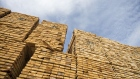 Softwood lumber sits in stacks at the Groupe Crete Inc. sawmill in Chertsey, Quebec, Canada, on Tuesday, Sept. 4, 2018. Lumber futures for November delivery rose $12.10, or 3%, to $414.70 per 1,000 board feet on the Chicago Mercantile Exchange after jumping by the maximum.