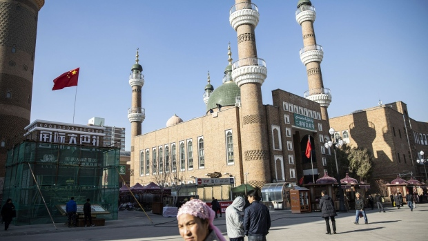 Pedestrians walk past the Erdao Bridge Mosque, center, in Urumqi, Xinjiang autonomous region, China, on Tuesday, Nov. 6, 2018. Although it represents just 1.5 percent of China's population and 1.3 percent of its economy, Xinjiang sits at the geographic heart of Xi's signature Belt and Road Initiative. Source: Bloomberg/Bloomberg