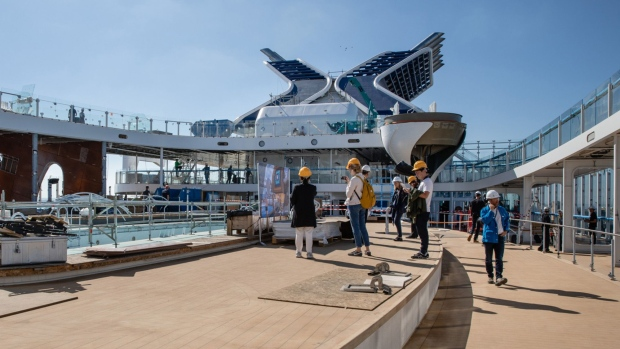 Visitors inspect the Resort deck area as construction work continues aboard the Celebrity Edge cruise ship, operated by Royal Caribbean Cruises Ltd, during a press tour at the Chantiers de l'Atlantique shipyard in Saint Nazaire, France.