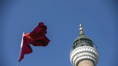 A Chinese flag flies in front of a mosque in Urumqi, capital of the northwestern province of Xinjiang.