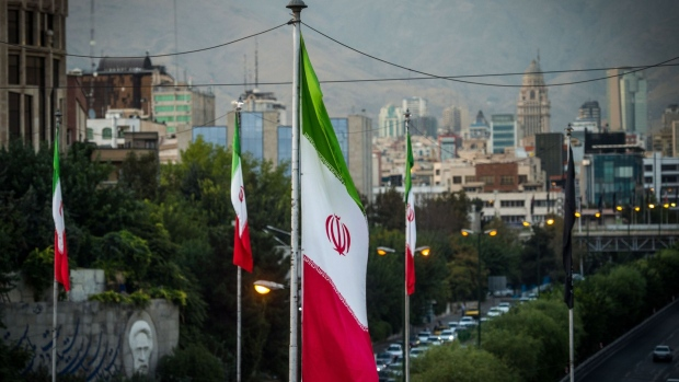 Iranian national flags fly near a major highway through Tehran, Iran, on Tuesday, Sept. 17. 2019. Iranian Foreign Minister Mohammad Javad Zarif refused to rule out military conflict in the Middle East after the U.S. sent more troops and weapons to Saudi Arabia in response to an attack on oil fields the U.S. has blamed on the Islamic Republic.