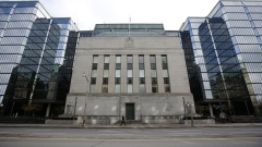 A pedestrian walks past the Bank of Canada building in Ottawa, Ontario, Canada, on Wednesday, Oct. 28, 2020. The Bank of Canada said the country's economy wont fully absorb slack in the economy before 2023, suggesting it will keep rates at near zero for the next few years.