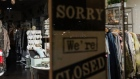 "A ""Sorry We're Closed"" sign inside a clothing store at the Del Mar Highlands Town Center outdoor mall in San Diego, California."