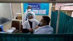 Healthcare workers administer a dose of Bharat Biotech Ltd. Covaxin vaccine for coronavirus at Sanjeevan Hospital in Daryaganj, New Delhi, India, on Thursday, Feb. 11, 2021. India is the second-worst virus-hit country in the world, trailing only the U.S. with more than 10.9 million infections. Photographer. T. Narayan/Bloomberg