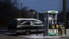 A hearse parked at a gas station in Austin, Texas, U.S., on Wednesday, Feb. 17, 2021. The crisis that has knocked out power for days to millions of homes and businesses in Texas and across the central U.S. is getting worse, with blackouts expected to last until at least Thursday.