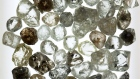 A collection of rough diamonds sit on a lightbox during sorting at the United Selling Organisation (USO) of Alrosa PJSC sorting center in Moscow, Russia, on Tuesday, Feb. 12, 2019. Alrosa PJSC, one of the world's top diamond miners, is returning to crisis-stricken Zimbabwe, the latest example of Russia expanding its footprint in Africa.
