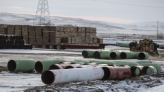 Pipes for the Keystone XL pipeline stacked in a yard near Oyen, Alberta, Canada, on Tuesday, Jan. 26, 2021. U.S. President Joe Biden revoked the permit for TC Energy Corp.'s Keystone XL energy pipeline via executive order hours after his inauguration, the clearest sign yet that constructing a major new pipeline in the U.S. has become an impossible task.