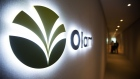 The Olam International Ltd. logo is displayed at the company's office in Singapore, on Monday, Aug. 14, 2017. Olam predicts cocoa market conditions will stabilize this half after volatile prices hit earnings for another quarter. Photographer: Nicky Loh/Bloomberg