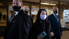 Meng Wanzhou, chief financial officer of Huawei Technologies Co., center, exits Supreme Court after a hearing in Vancouver, British Columbia, Canada, on Friday, Jan. 29, 2021. Meng's request to loosen the bail terms set during her release from jail in 2018 has been rejected, a Canadian judge ruled on Friday, as she fights a U.S. extradition case.