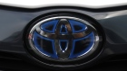 The Toyota Motor Corp. logo is seen on a Prius PHV plug-in hybrid vehicle equipped with a solar charging system in Tokyo Japan, on Tuesday, Sept. 11, 2019. Toyota, Sharp Corp. and New Energy and Industrial Technology Development Organization of Japan, or NEDO, are testing a new solar-powered Prius since July. Photographer: Toru Hanai/Bloomberg