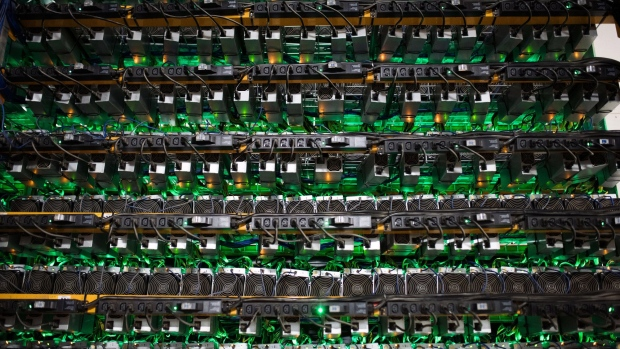 Cryptocurrency mining rigs sit on racks at a Bitfarms facility in Saint-Hyacinthe, Quebec, Canada, on Thursday, July 26, 2018. Bitcoin has rallied more than 30 percent in July, shrugging off security and regulatory concerns that have plagued the virtual currency for much of this year. Photographer: James MacDonald/Bloomberg