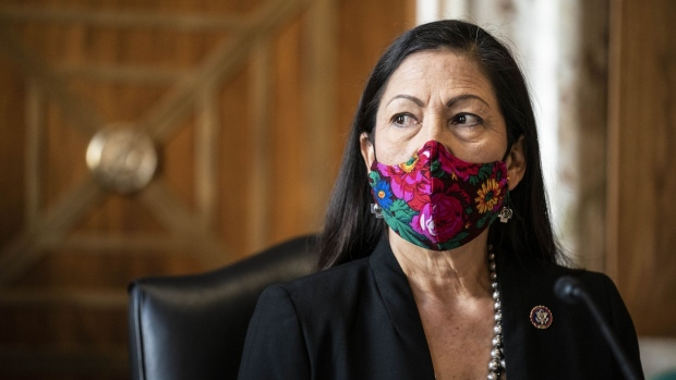 Representative Deb Haaland, a Democrat from New Mexico and secretary of the interior nominee for U.S. President Joe Biden, wears a protective mask before testifying during a Senate Energy and Natural Resources Committee confirmation hearing in Washington, D.C., U.S., on Wednesday, Feb. 24, 2021. Haaland downplayed her past opposition to fracking during a heated hearing yesterday as she sought to reassure senators worried she would clamp down on fossil fuel development.