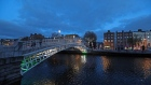 The River Liffey flows beneath the Ha'penny bridge in Dublin, Ireland, on Thursday, Nov. 24, 2016. Irish ministers and executives are closely monitoring economic and market developments in the U.K. because the country is Ireland's largest trading partner along with the U.S. Photographer: Chris Ratcliffe/Bloomberg