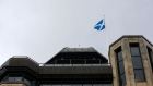 The Saltire, Scottish national flag, flies above the Standard Life Plc head office in Edinburgh, U.K., on Monday, March 6, 2017. Standard Life Plc, Scotland's largest insurer, agreed to acquire Aberdeen Asset Management Plc for about 3.8 billion pounds ($4.7 billion), a deal that would create the U.K.'s largest active manager. Photographer: Matthew Lloyd/Bloomberg