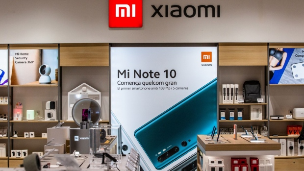 Xiaomi Corp. smartphones and tech products on display inside the AliExpress plaza retail store, operated by Alibaba Group Holding Ltd., in Barcelona, Spain, on Wednesday, Jan. 13, 2020. U.S. officials deliberated but ultimately decided against banning American investment in Alibaba and Tencent Holdings Ltd., a person familiar with the discussions said, removing a cloud of uncertainty over Asia's two biggest corporations.