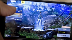 The Epic Games Inc. Fortnite: Battle Royale video game is displayed for a photograph on an Apple Inc. iPhone in Washington, D.C., U.S., on Thursday, May 10, 2018. Fortnite, the hit game that's denting the stock prices of video-game makers after signing up 45 million players, didn't really take off until it became free and a free-for-all. Photographer: Andrew Harrer/Bloomberg