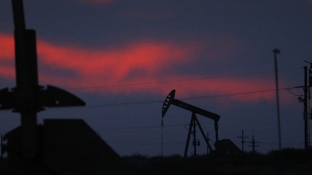 The silhouettes of electric oil pump jacks are seen at dusk in the oil fields surrounding Midland, Texas, U.S., on Tuesday, Nov. 7, 2017. Nationwide gross oil refinery inputs will rise above 17 million barrels a day before the year ends, according to Energy Aspects, even amid a busy maintenance season and interruptions at plants in the U.S. Gulf of Mexico that were clobbered by Hurricane Harvey in the third quarter.