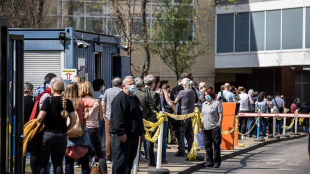 Patients wait in line outside a vaccination point at Semmelweis University Hospital in Budapest, Hungary, on Thursday, April 1, 2021. Hungarian Prime Minister Viktor Orban vowed to ease virus curbs soon even as his nation has the world's highest Covid-19 death rate and reported a big jump in fatalities.