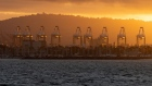 Gantry cranes at sunset at the Port of Long Beach in Long Beach, California. Photographer: Bing Guan/Bloomberg