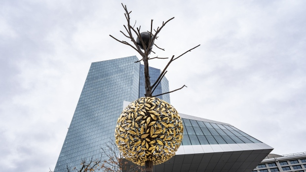 "A bronze and granite tree-shaped sculpture entitled Gravity and Growth stands outside the European Central Bank (ECB) headquarters in Frankfurt, Germany, on Wednesday, Nov. 27, 2019. ECB President Christine Lagarde said ""support for the euro has reached an all-time high"". Photographer: Peter Juelich/Bloomberg"
