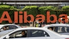 Vehicles travel past the Alibaba Group Holdings Ltd. headquarters in Hangzhou, China, on Wednesday, March 24, 2021.