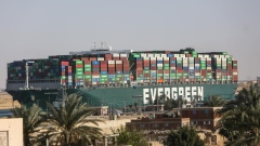 The Ever Given container ship moves along the Suez Canal towards Ismailia after being freed from the canal bank in Suez, Egypt, on Monday, March 29, 2021. The giant Ever Given container ship was finally pulled free from the bank of the Suez Canal, allowing for a massive tail back of ships to start navigating once again through one of the world's most important trade routes. Photographer: Islam Safwat/Bloomberg