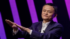 Jack Ma, chairman of Alibaba Group Holding Ltd., left, gestures while speaking during a fireside interview at the Viva Technology conference in Paris, France, on Thursday, May 16, 2019. Donald Trump's latest offensive against China's Huawei Technologies Co. puts Europe in an even bigger bind over which side to pick, but France's President Emmanuel Macron is holding the line.