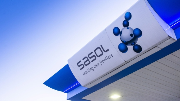 A sign hangs on the ceiling of a Sasol Ltd. fuel station in Pretoria, South Africa, on Thursday, June 4, 2020. South Africa's state-owned Central Energy Fund is considering buying assets that have been put on the block by fuel and chemical maker Sasol Ltd. as it seeks to restore itself to profitability.