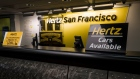 Signage is displayed at the Hertz Global Holdings Inc. rental counter at San Francisco International Airport in San Francisco.