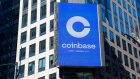 A monitor displays Coinbase signage during the company's initial public offering (IPO) at the Nasdaq MarketSite in New York, U.S., on Wednesday, April 14, 2021. Coinbase Global Inc., the largest U.S. cryptocurrency exchange, is set to debut on Wednesday through a direct listing, an alternative to a traditional initial public offering that has only been deployed a handful of times. Photographer: Michael Nagle/Bloomberg