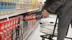 A shopper takes a case of Coca-Cola Co. Zero soft drinks at a store in Orem, Utah, U.S., on Tuesday, Feb. 9, 2021. Coca Cola is scheduled to announce their fourth-quarter 2020 earnings tomorrow February 10. Coca-Cola Co.'s sales beat Wall Street's expectations in the fourth quarter, giving the soda maker a boost after nearly a year of global lockdowns at restaurants, amusement parks and stadiums that have disrupted its business. Photographer: George Frey/Bloomberg