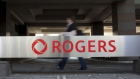 Signage is displayed outside Rogers Communications Inc. headquarters in Toronto, Ontario, Canada, on Wednesday, May 17, 2017. Rogers Communications, Canada's largest wireless carrier, is leveraging organic growth in the country's wireless market to expand its subscriber base. Photographer: Brent Lewin/Bloomberg