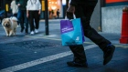 A takeaway food courier, working for Deliveroo, operated by Roofoods Ltd., walks with a customer's food order in London, U.K., on Tuesday, Sept. 29, 2020. Covid-19 lockdown enabled online and app-based grocery delivery service providers to make inroads with customers they had previously struggled to recruit, according the Consumer Radar report by BloombergNEF. Photographer: Hollie Adams/Bloomberg