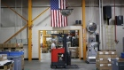 An American flag at a manufacturing facility in Virginia Beach, Virginia. Photographer: Luke Sharrett/Bloomberg
