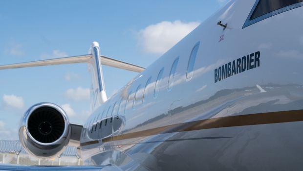 A Bombardier Inc. Global 6000 business jet stands on display during a media event at Seletar Aerospace Heights in Singapore, on Wednesday, Feb. 27, 2019. Bombardier is more than doubling the size of its bond buybacks to as much as $1.83 billion after raising twice the amount initially expected in its new debt sale on Thursday amid a red-hot junk-bond market. Photographer: Nicky Loh/Bloomberg