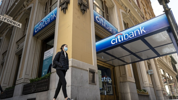 A pedestrian wearing a protective mask walks past a Citibank bank branch in San Francisco, California, U.S., on Tuesday, April 13, 2021. Citigroup Inc. is scheduled to release earnings figures on April 15.